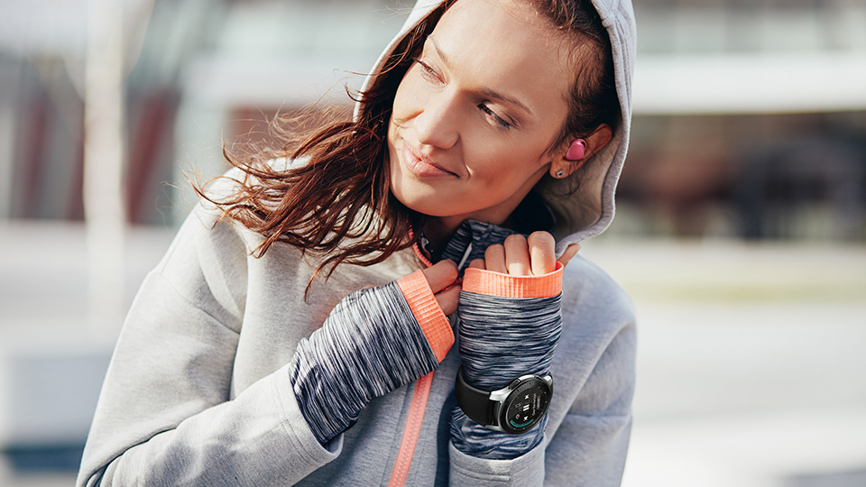 woman wearing the Galaxy Watch outdoors