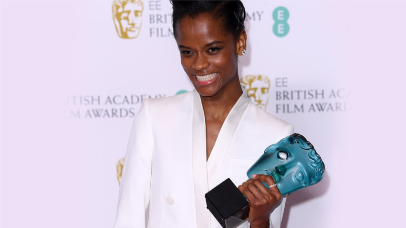 EE Rising Star Award winner Letitia Wright holding her award