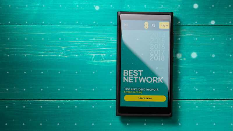 Phone screen displaying the EE website on an aqua backdrop