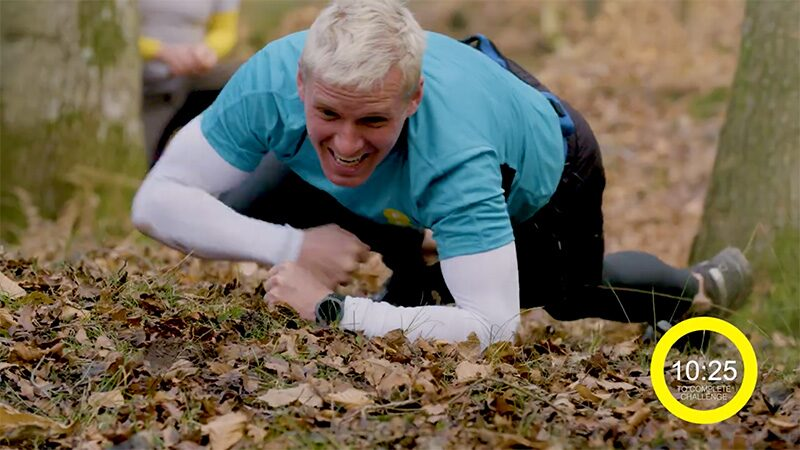 Jamie Laing crawls through leaves on the ground during his 30-minute SAS-inspired fitness challenge