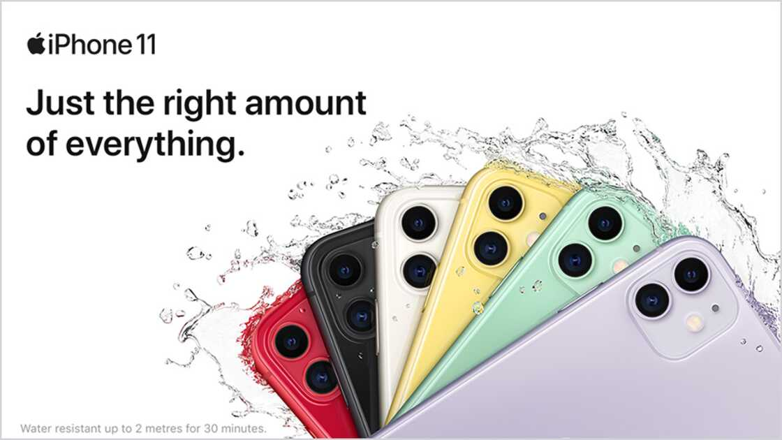 Six iPhone 11 smartphones in different colours with water splashing over them