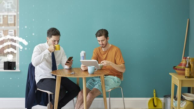 Two guys using their devices on WiFi