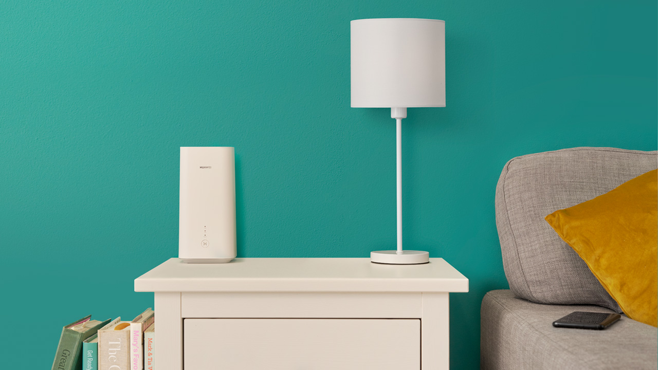 White 5GEE Home router on a side table in a living room