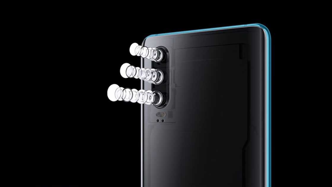 The back of a Huawei P30 shown on a black background with the flash components deconstructed