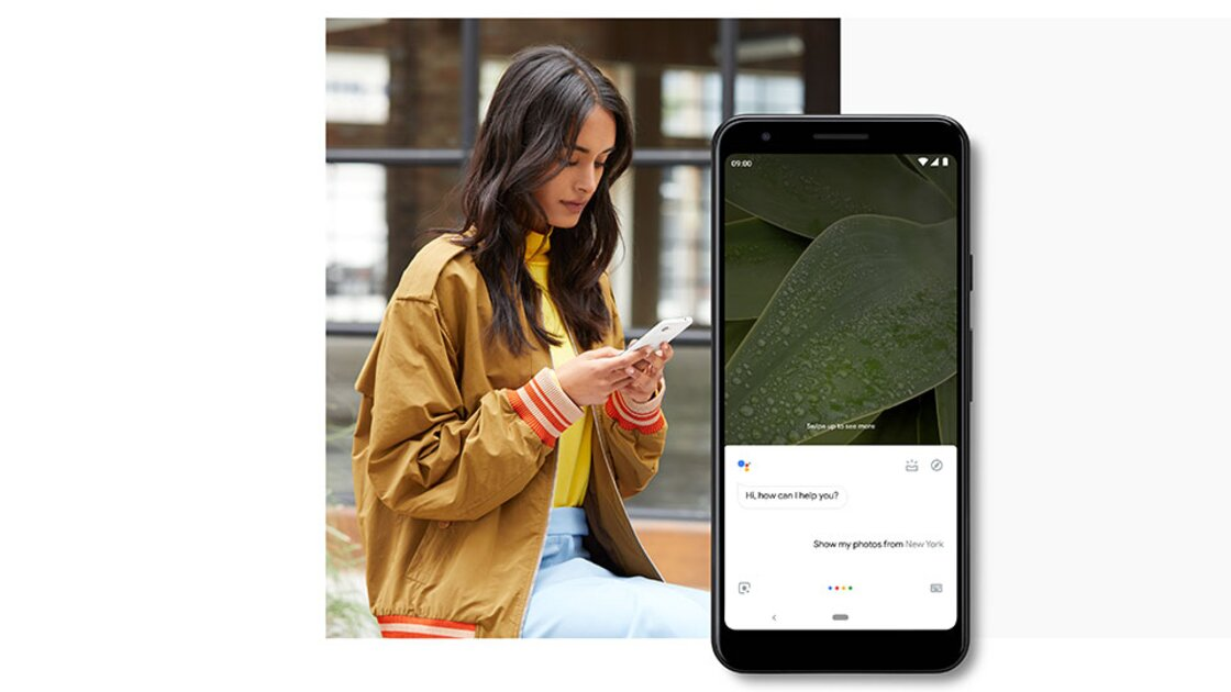 Dark haired girl sitting using the Google Assistant feature on her Google Pixel 3a