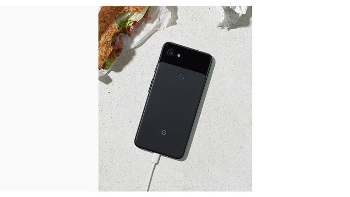 Rear view of a Just Black Google Pixel 3a on a table being charged-up