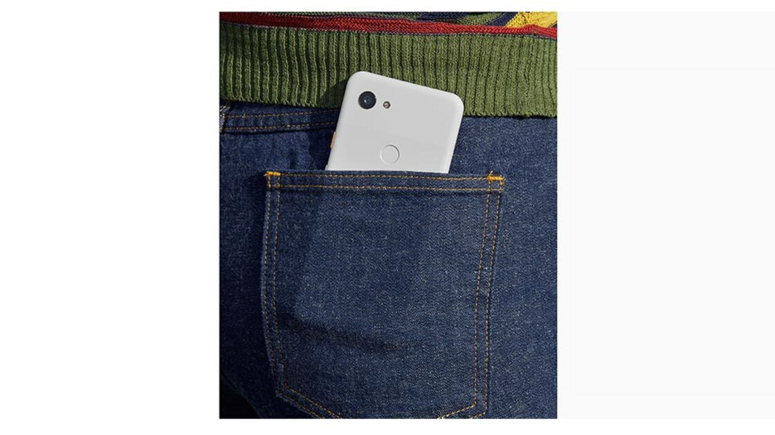 Rear view of a Clearly White Google Pixel 3a placed inside the back pocket of a pair of blue denim jeans