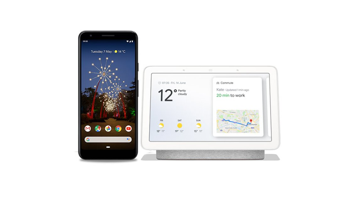 Google Pixel 3a Just Black smartphone positioned next to a Google Home Hub