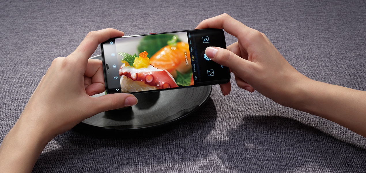 someone photographing food on the Huawei Mate 20 Pro