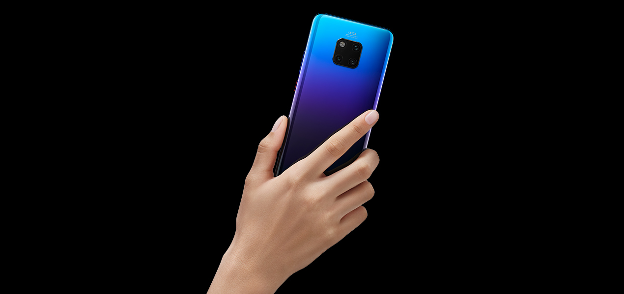 someone holding the Huawei Mate 20 Pro showing the back of the phone