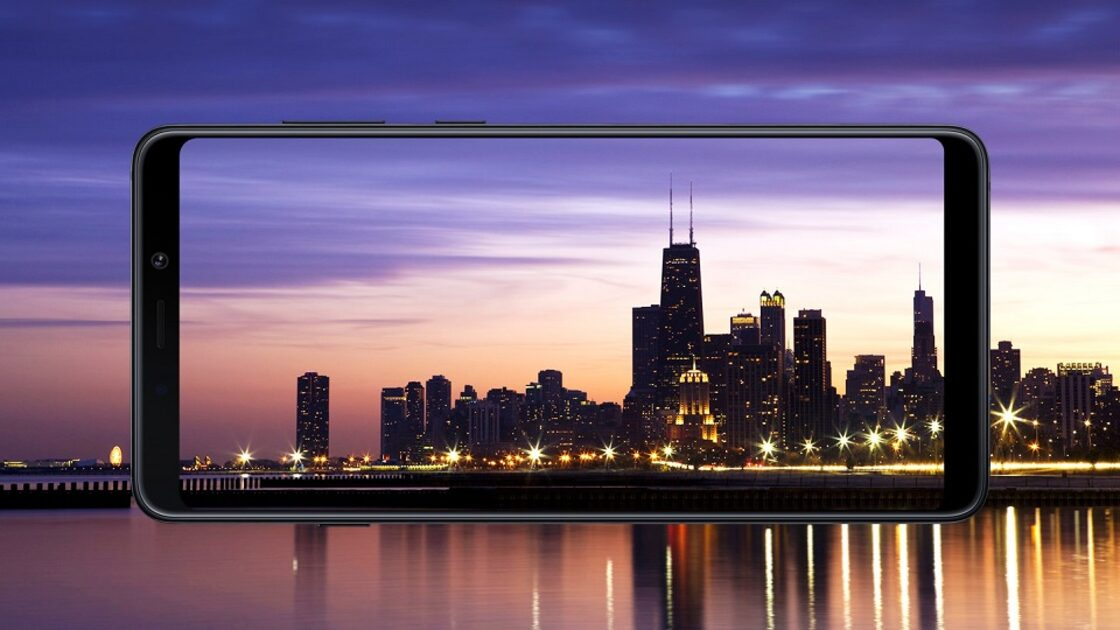 Samsung Galaxy A9 display with city image in background