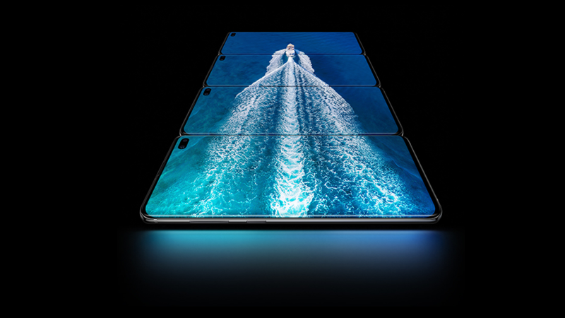 Four Samsung Galaxy S10 phones stacked together showing a photo of a boat in the ocean