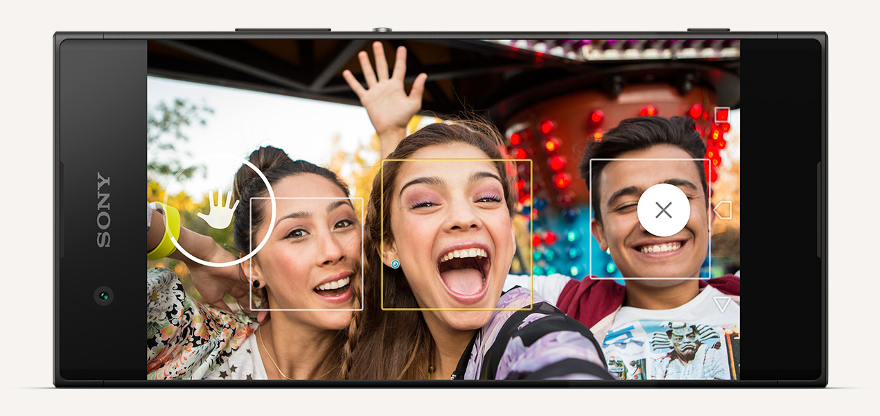 People taking a selfie with the Sony Xperia XA1