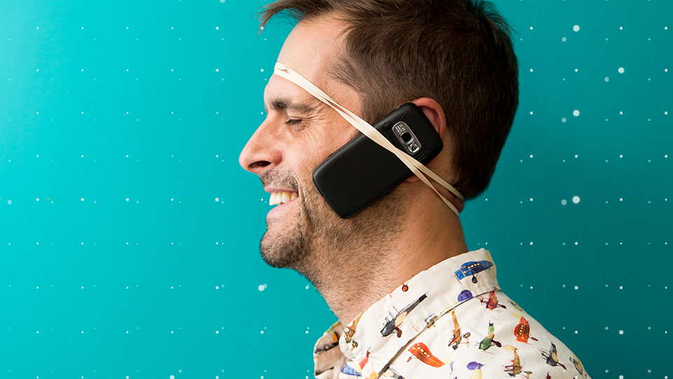Man with phone strapped to his face
