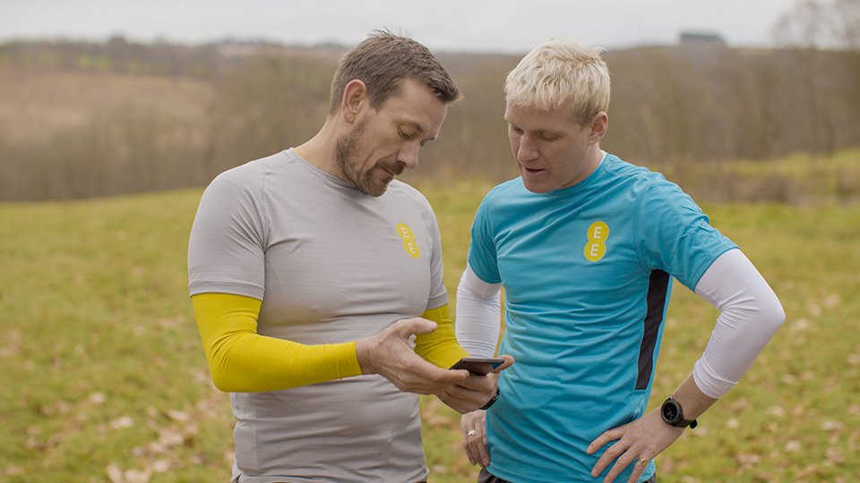 Jamie and Ollie training together, looking at their Galaxy smartphone