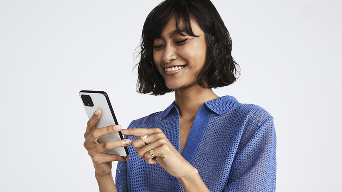 Smiling lady chooses her favourite apps on her Google Pixel 4 to activate the Adaptive Battery feature