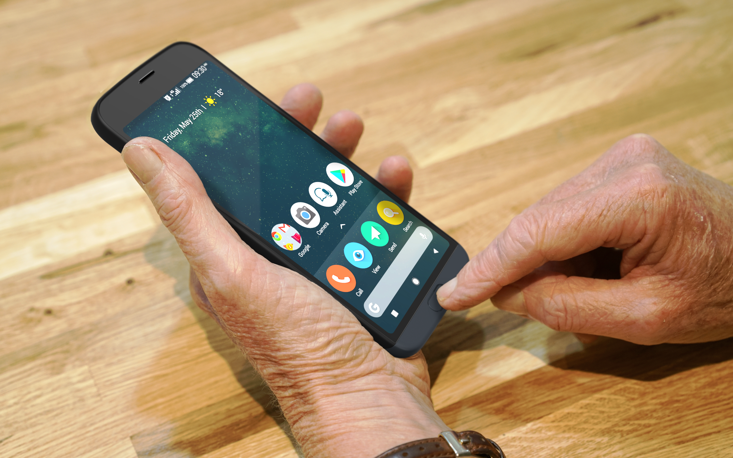 an older man's hands holding and using the touchscreen on a Doro phone