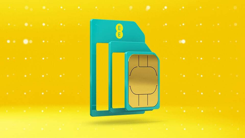 EE SIM card on yellow background